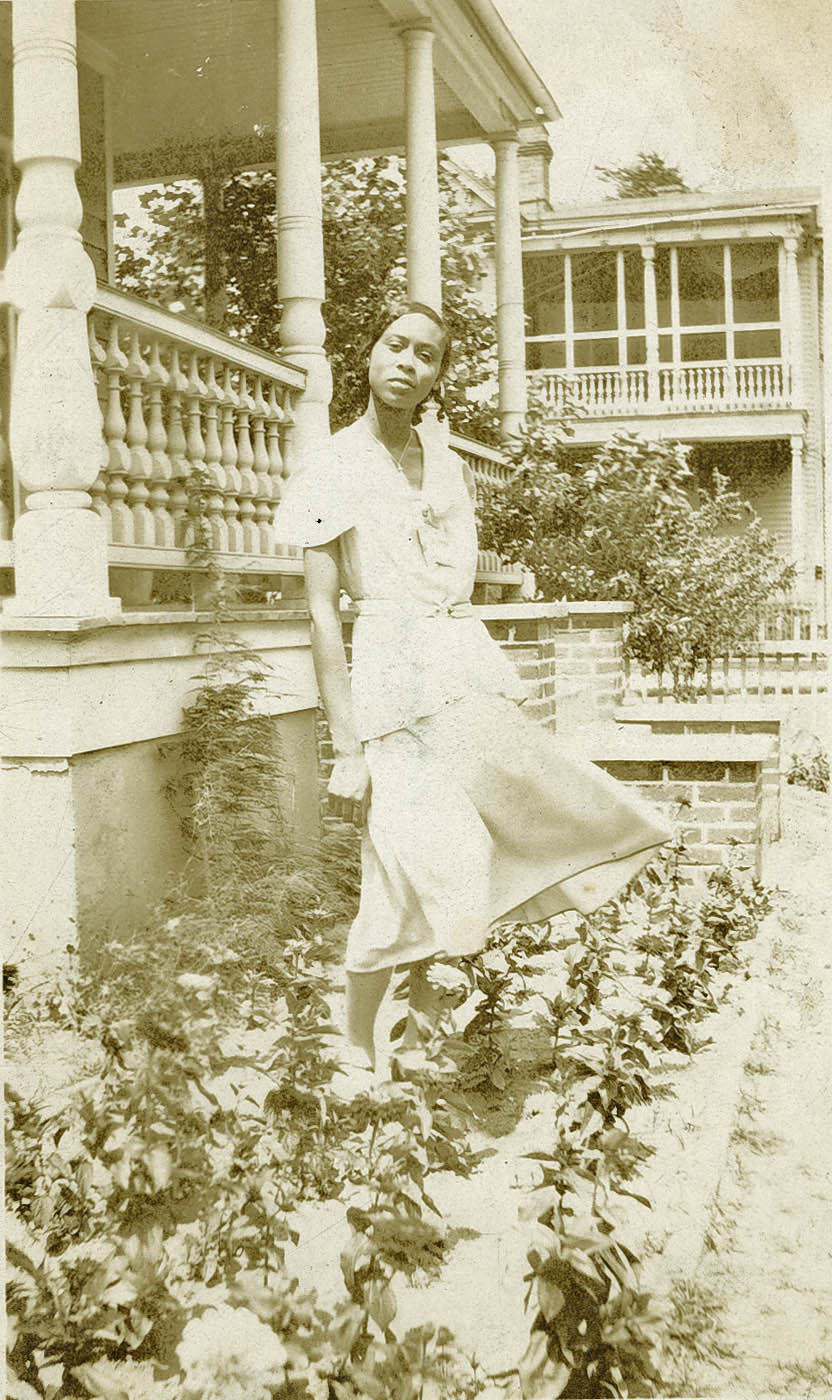 Avery Student Posed in Flowerbed