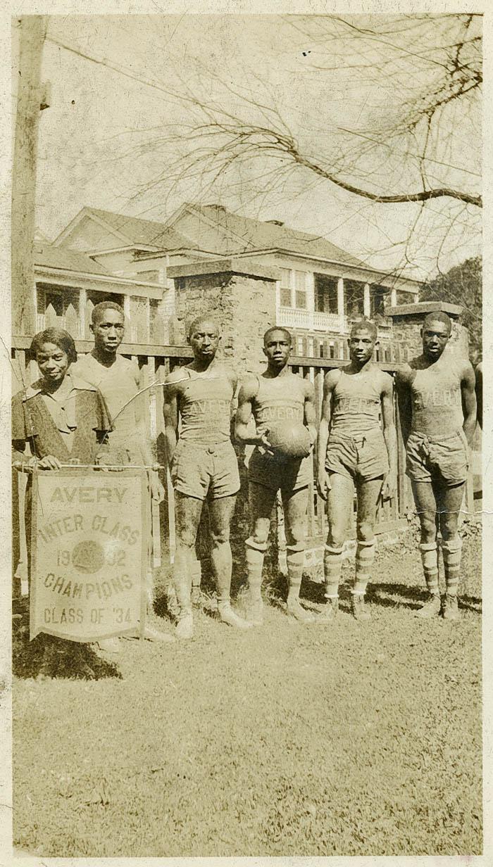 Members of the Avery Men's Basketball Team Pose with Teacher, Mrs. Singleton