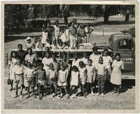 Photograph of Children Standing by a U.S. Army Vehicle