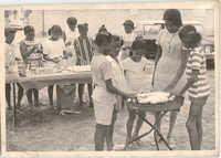 Photograph of Children Serving Food