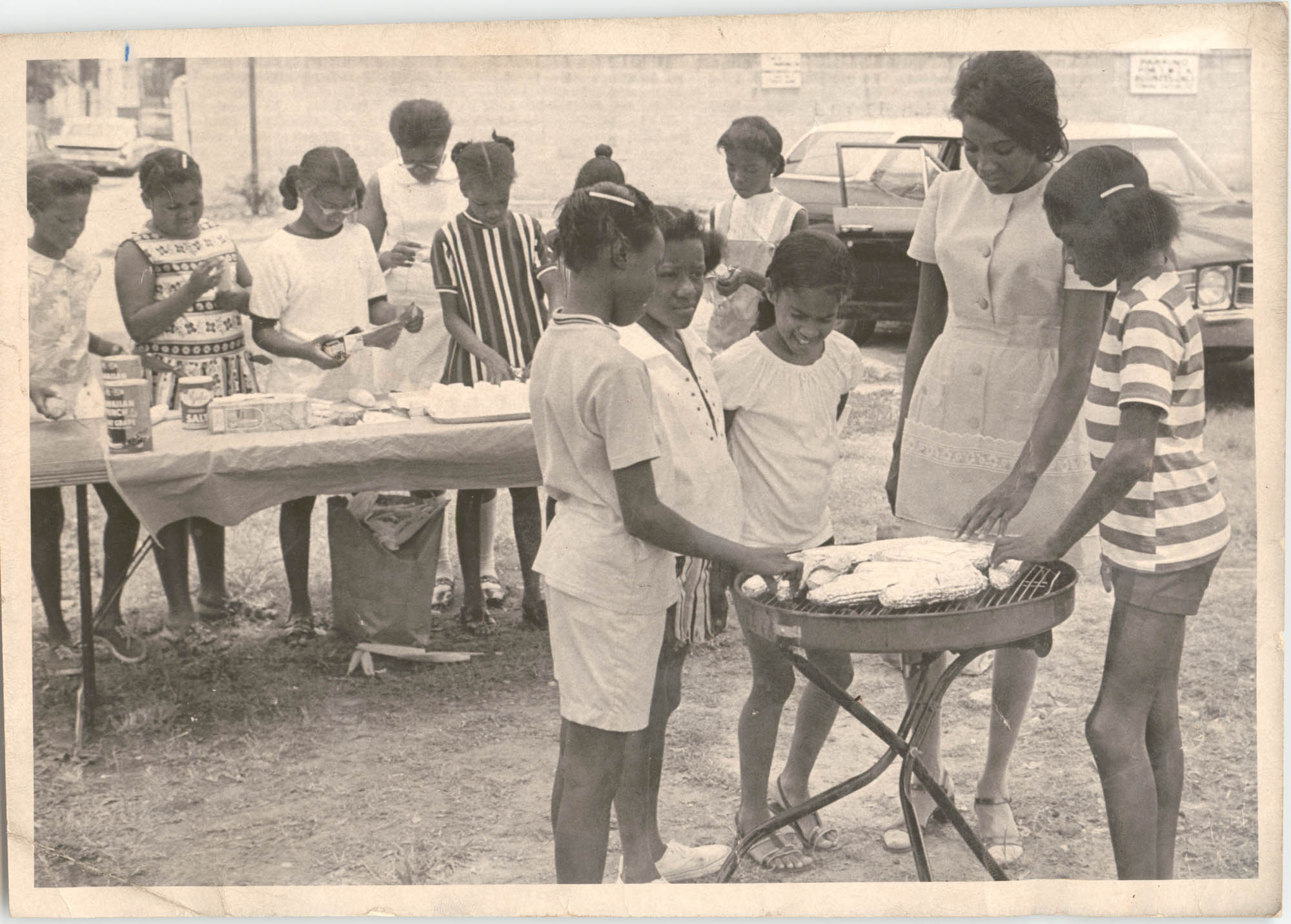 Photograph of Children Serving Food