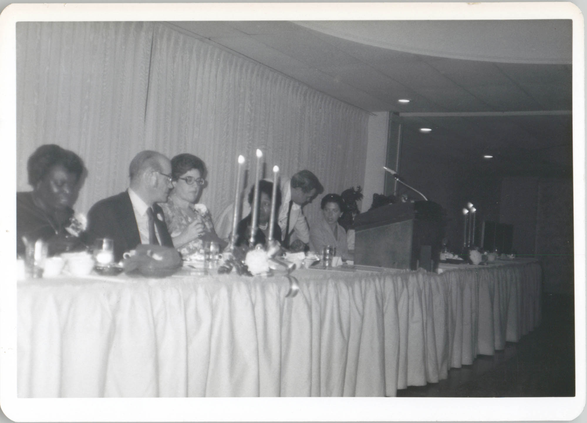 Photograph of People Seated at a Banquet Table