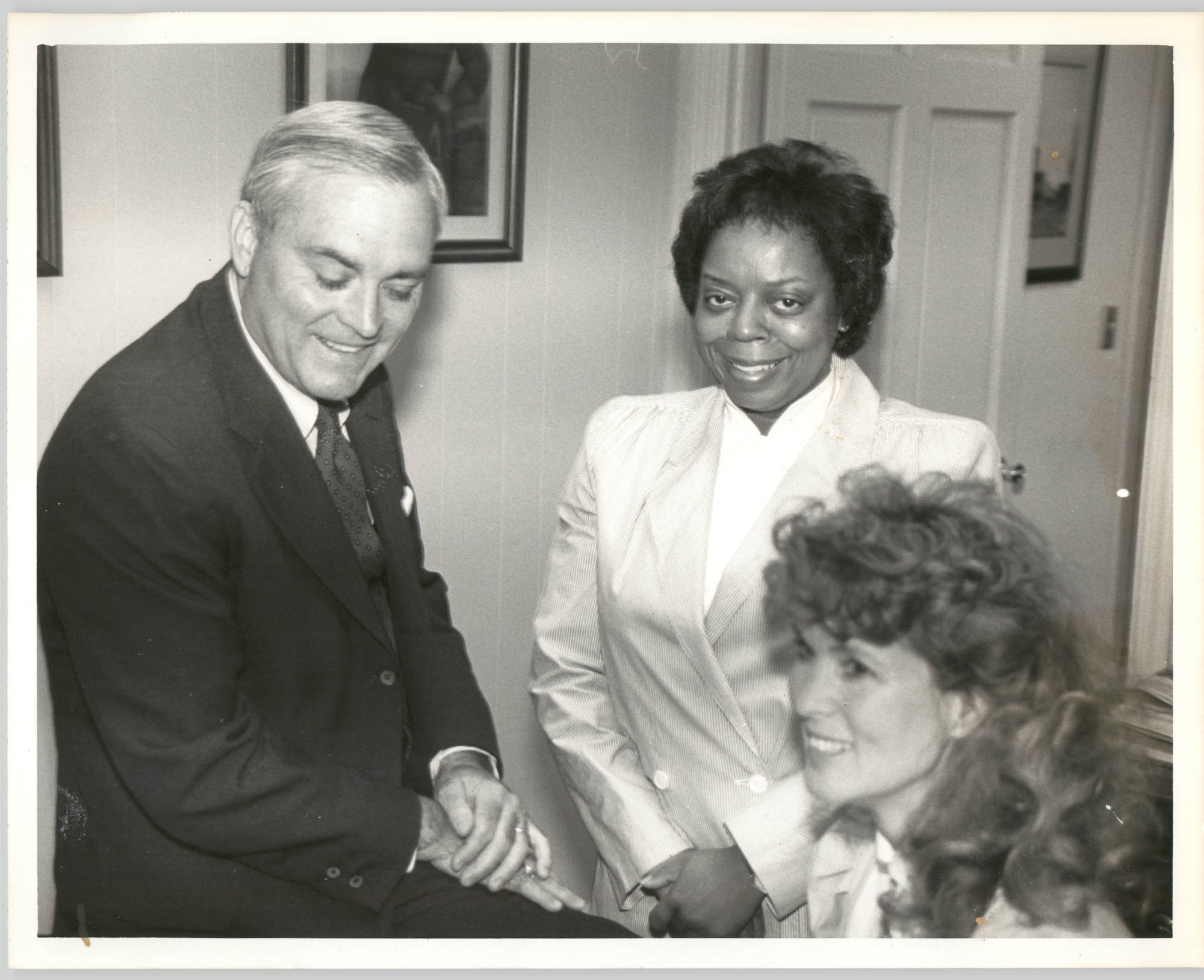 Photograph of Two Women and a Man