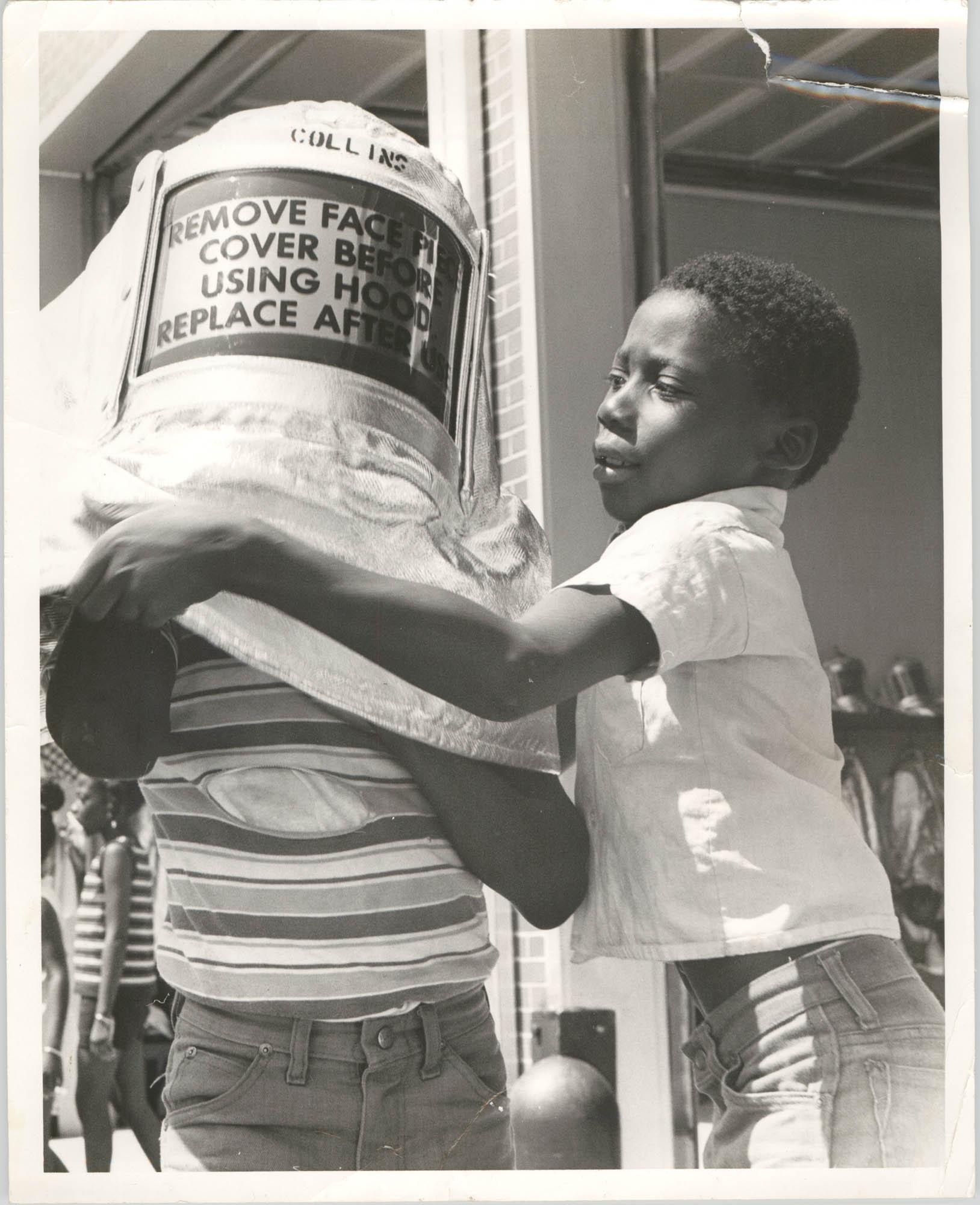 Photograph of a Child Wearing a Fireman Mask