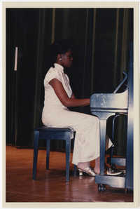 Photograph of a Young Woman Playing Piano