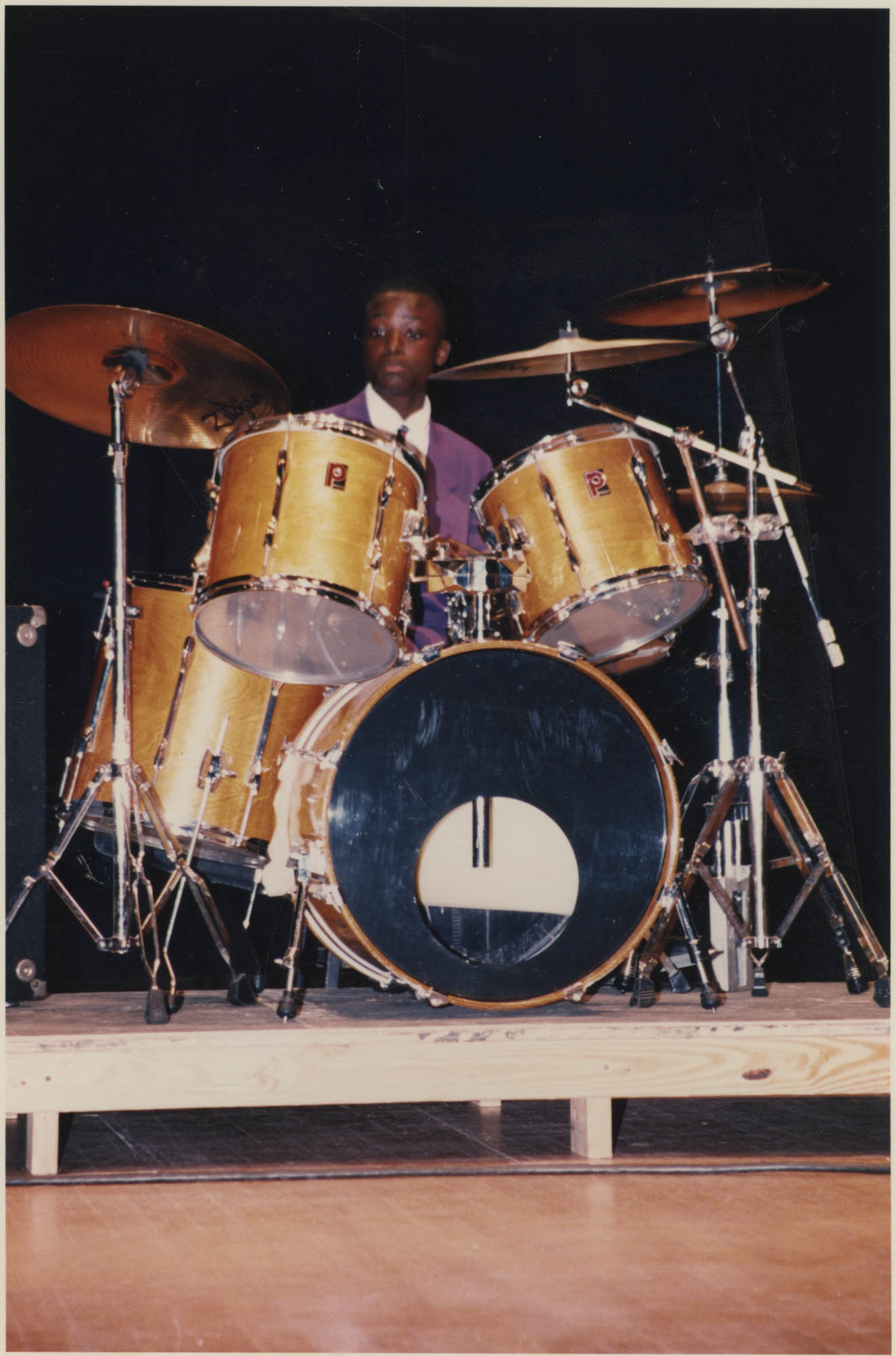 Photograph of a Young Man Playing Drums