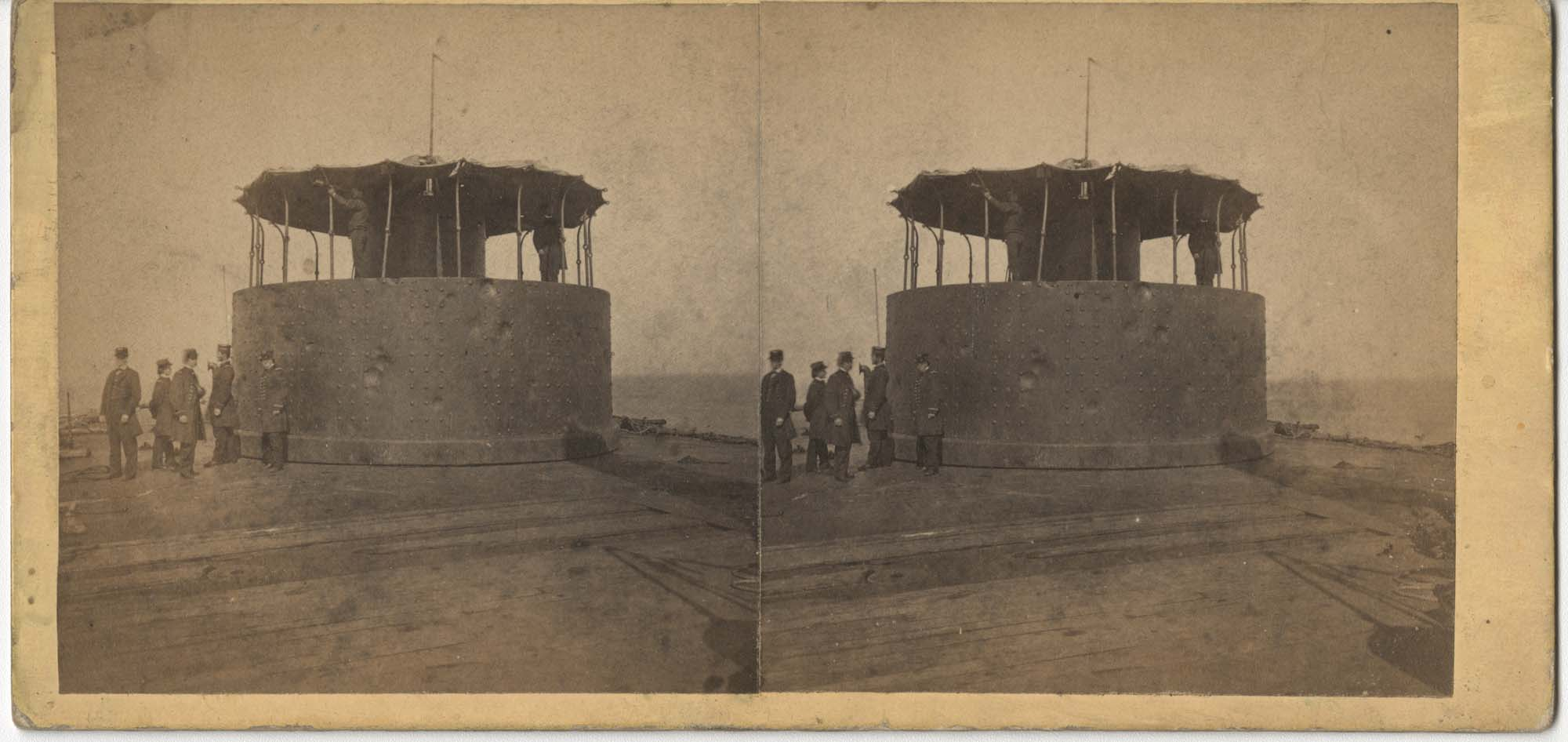 Men Standing with a Ship Tower