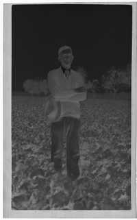 Negative of Man Wearing Cardigan in Field