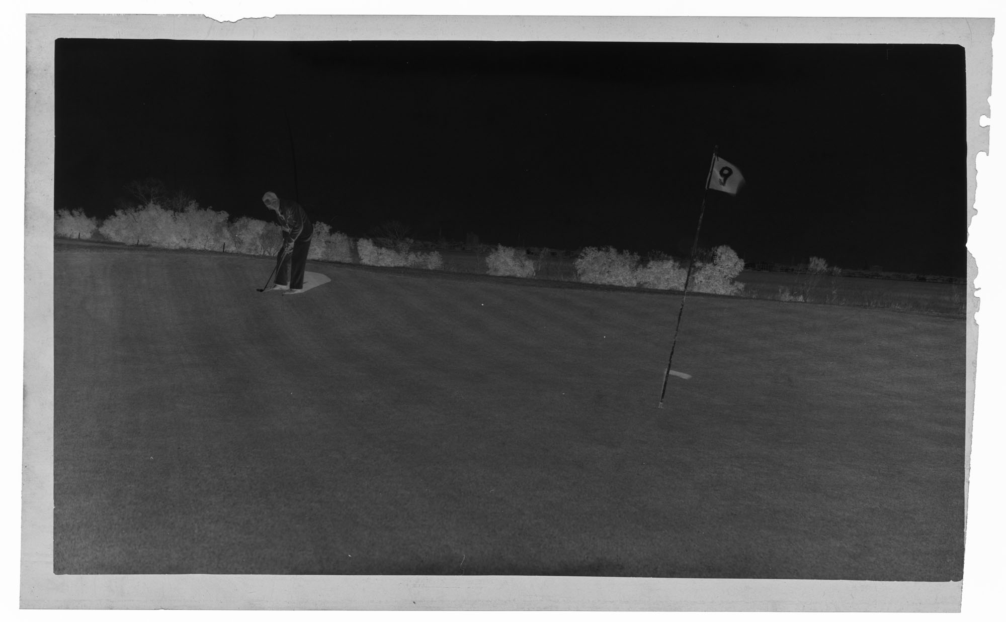 Negative of Golfing at the Ninth