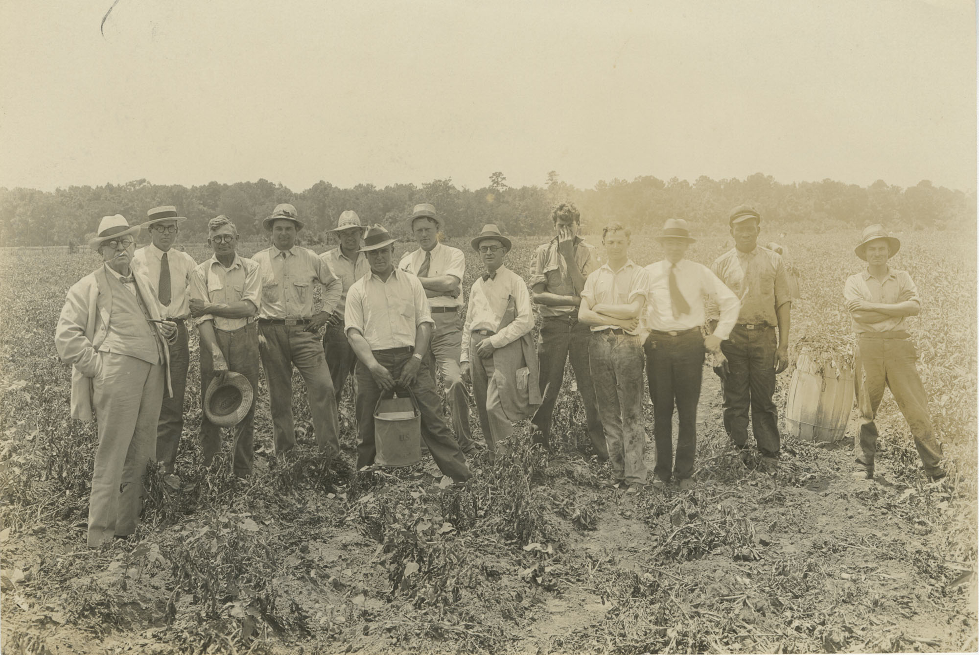 Several Men in a Field During a Fertilizer Inspection