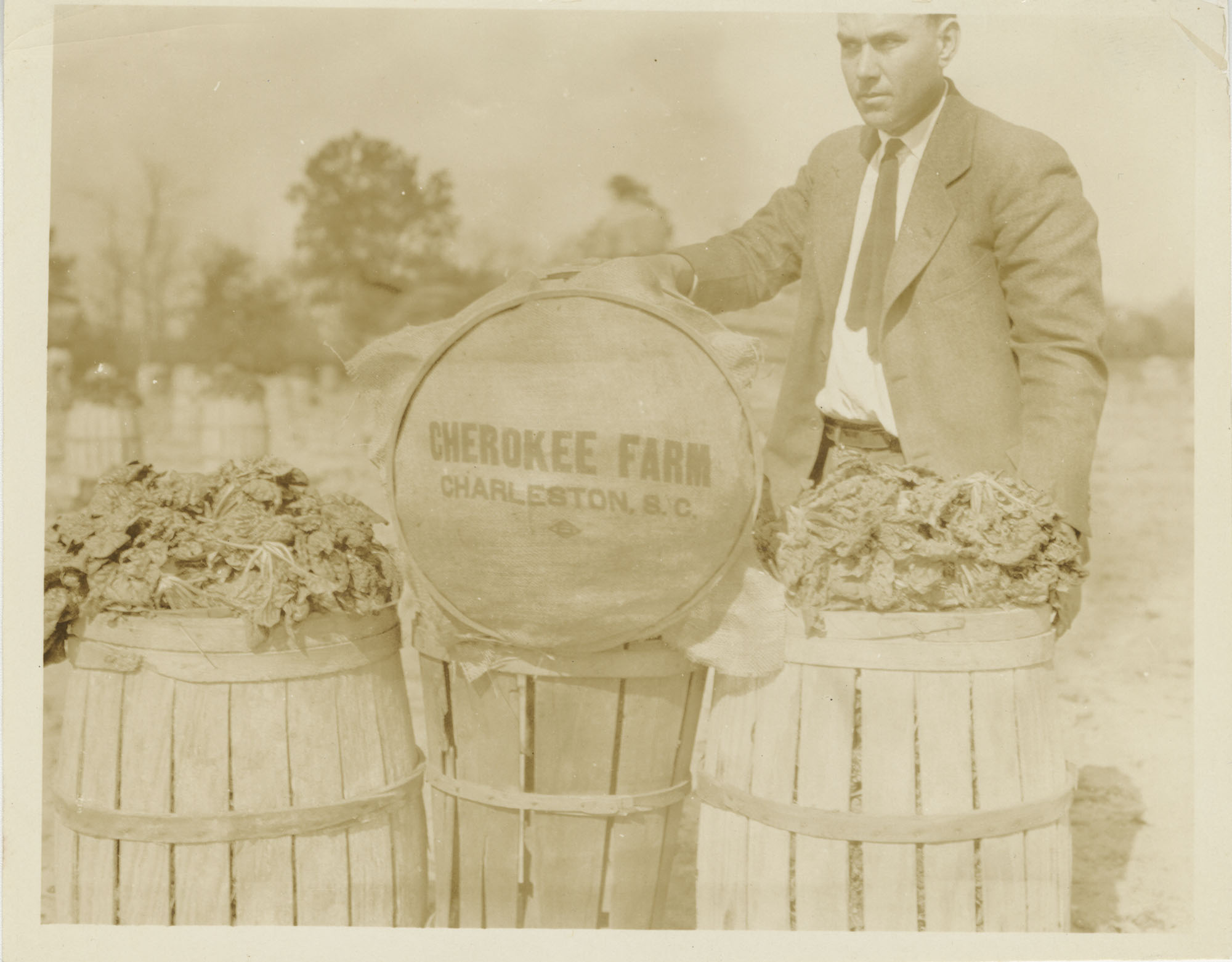 Man with Barrels of Cherokee Farm Spinach