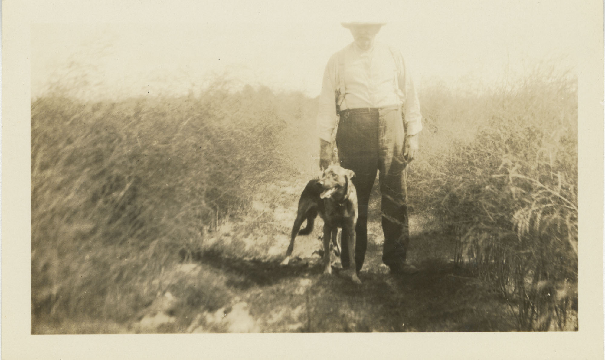 J.R. Scott in Asparagus Field with Dog