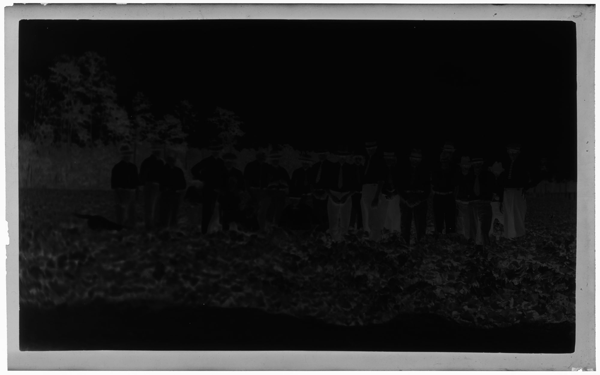 Negative of Men Gathering for a Group Photograph