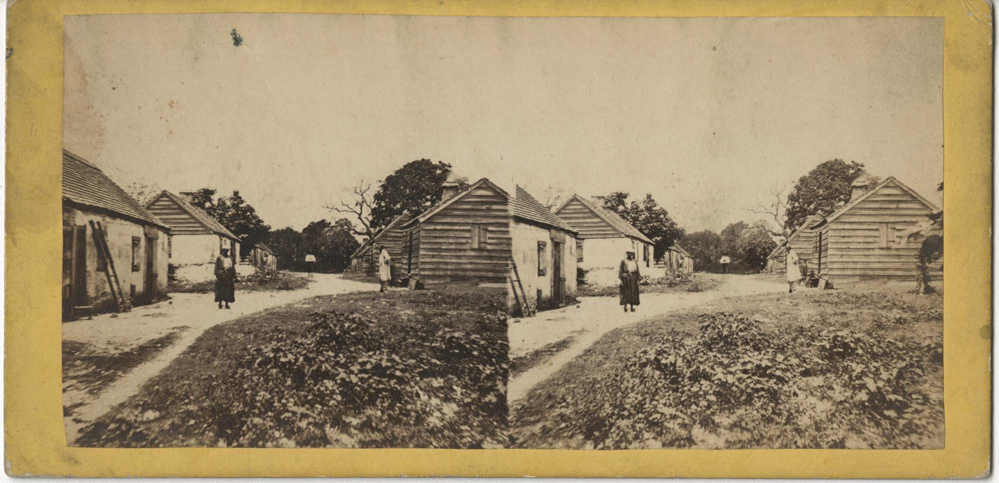 African Americans and Cabins at Battery Plantation