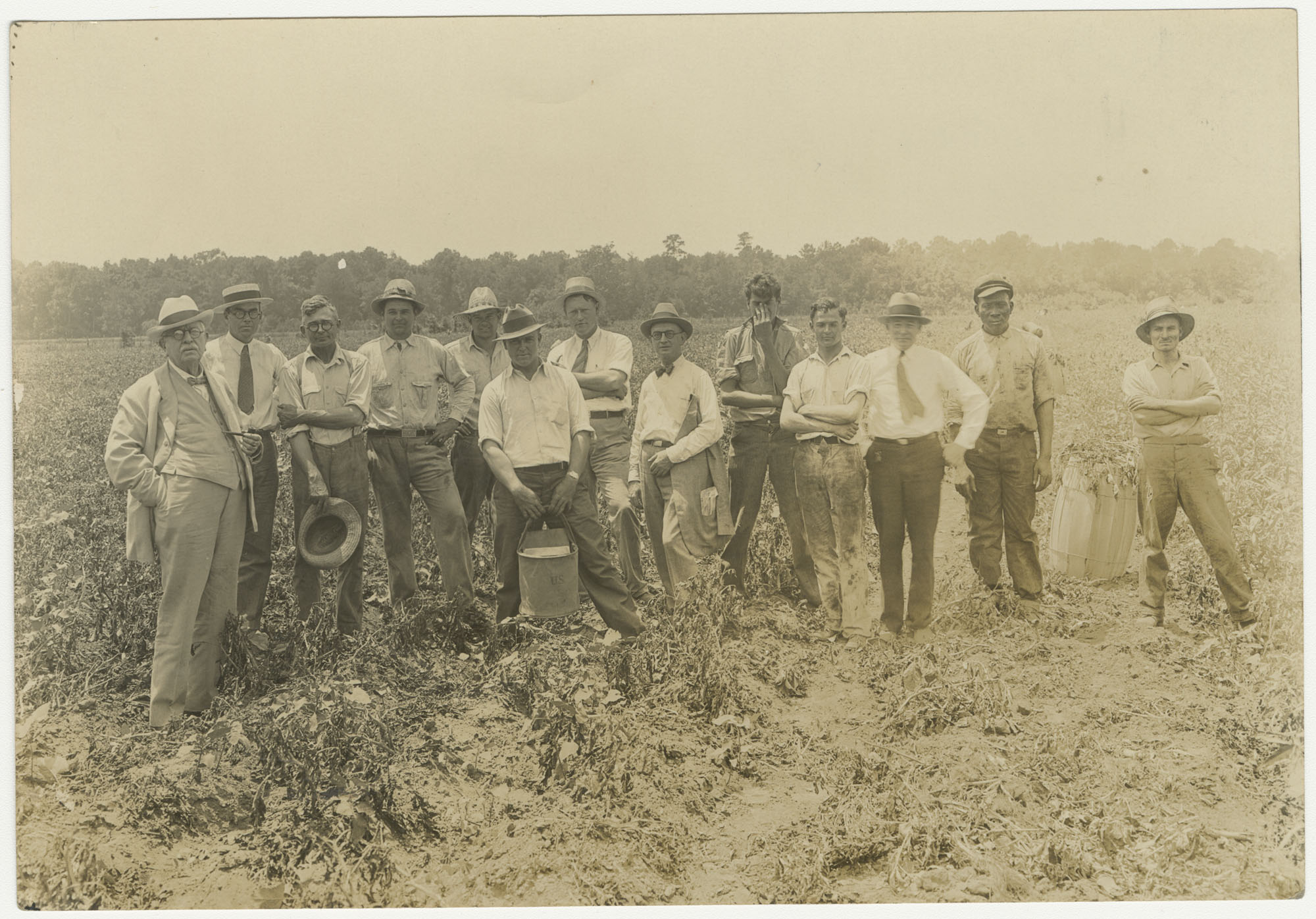 Several Men in a Field During a Fertilizer Inspection (Duplicate)