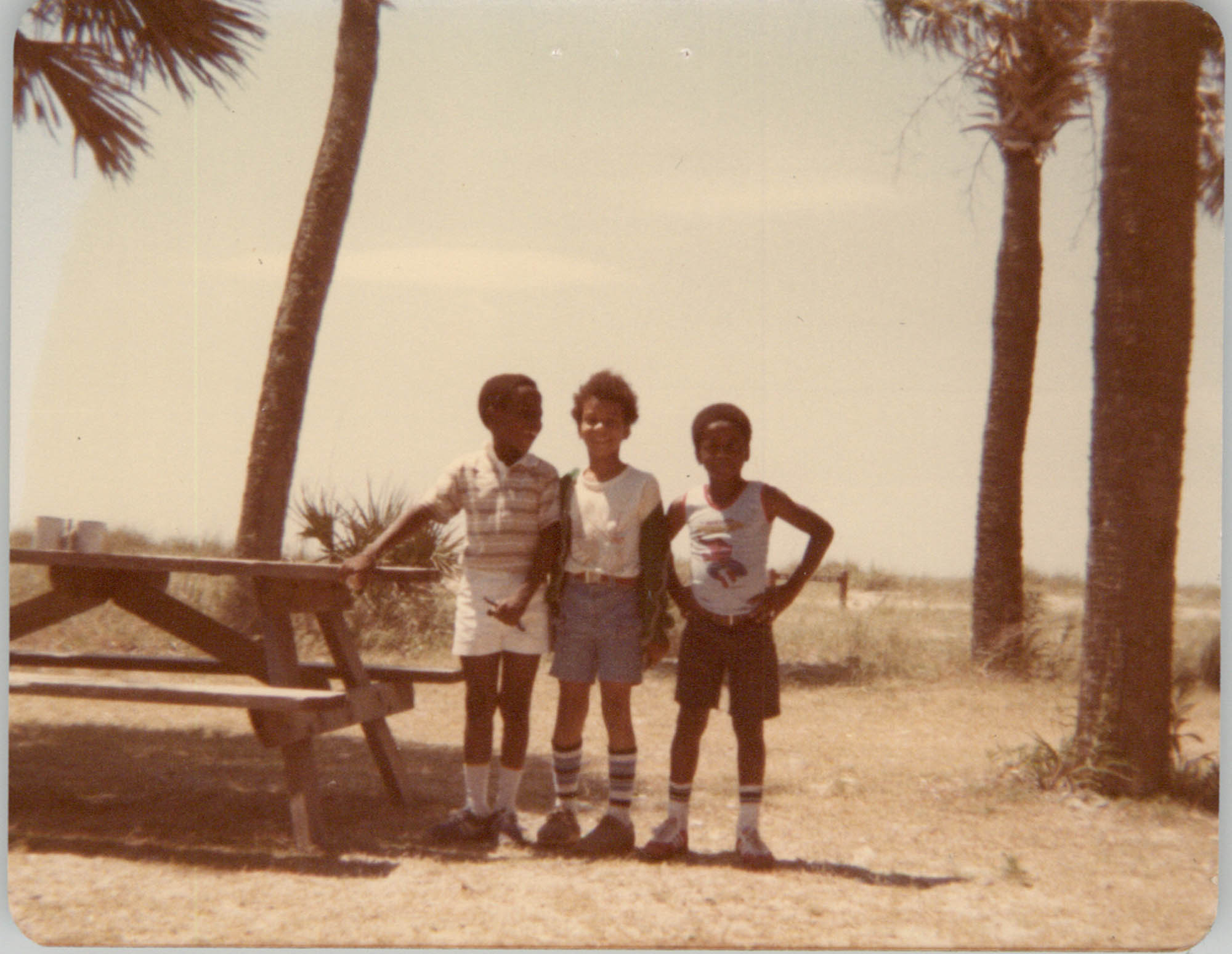 Photograph of Three Children Standing Outdoors