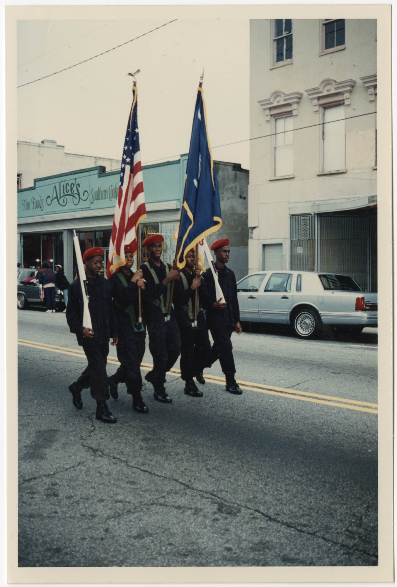 Photograph of Five Young Men Marching in a Parade