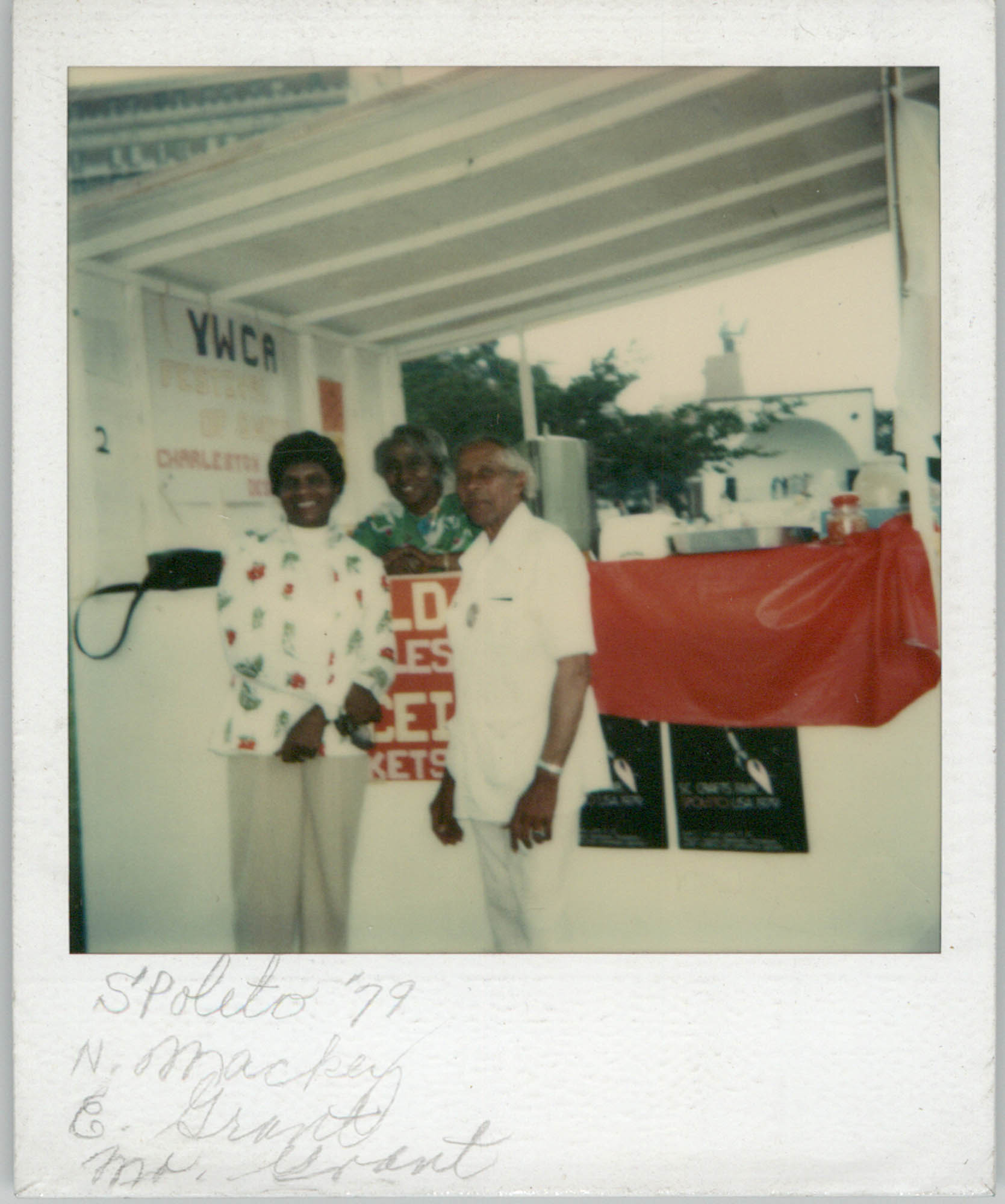 Photograph of N. Mackey, C. Grand, and Mr. Grant, 1979
