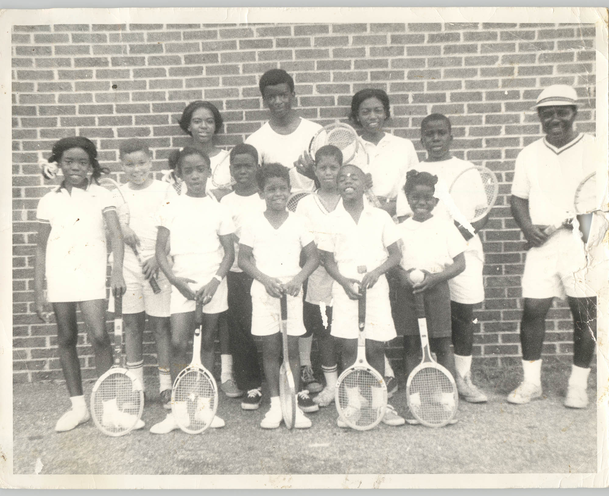 Photograph of Children with Tennis Rackets