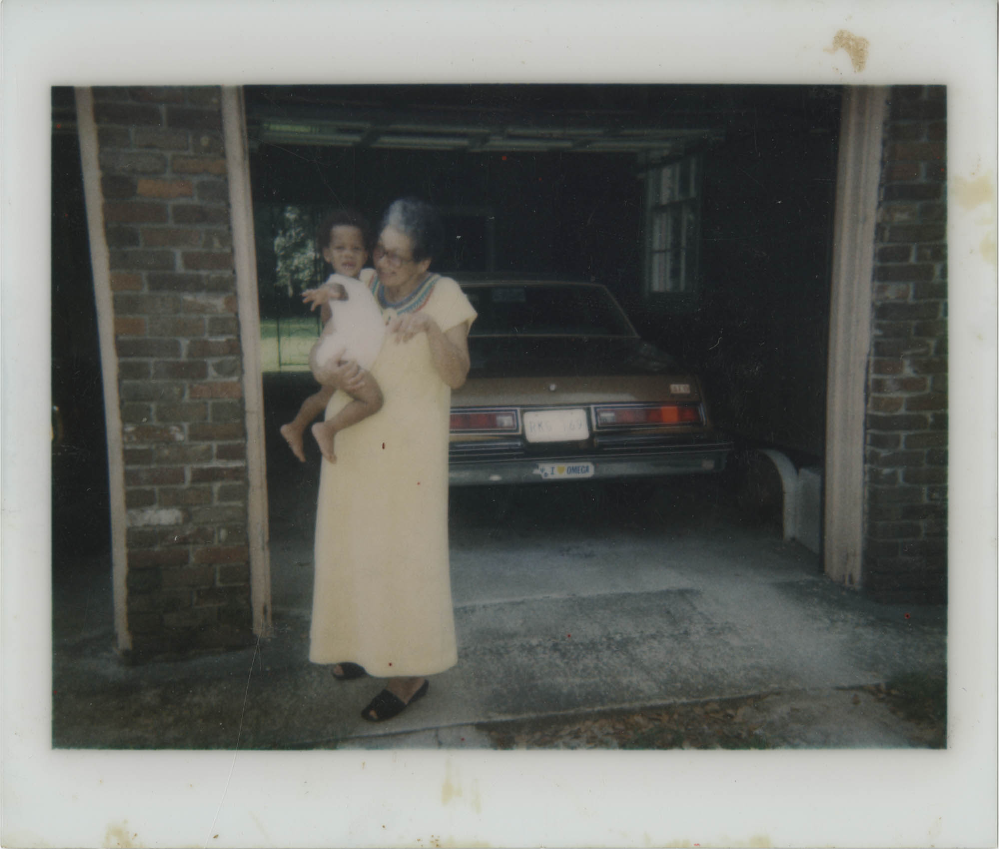 Photograph of MaeDe Brown Holding Baby