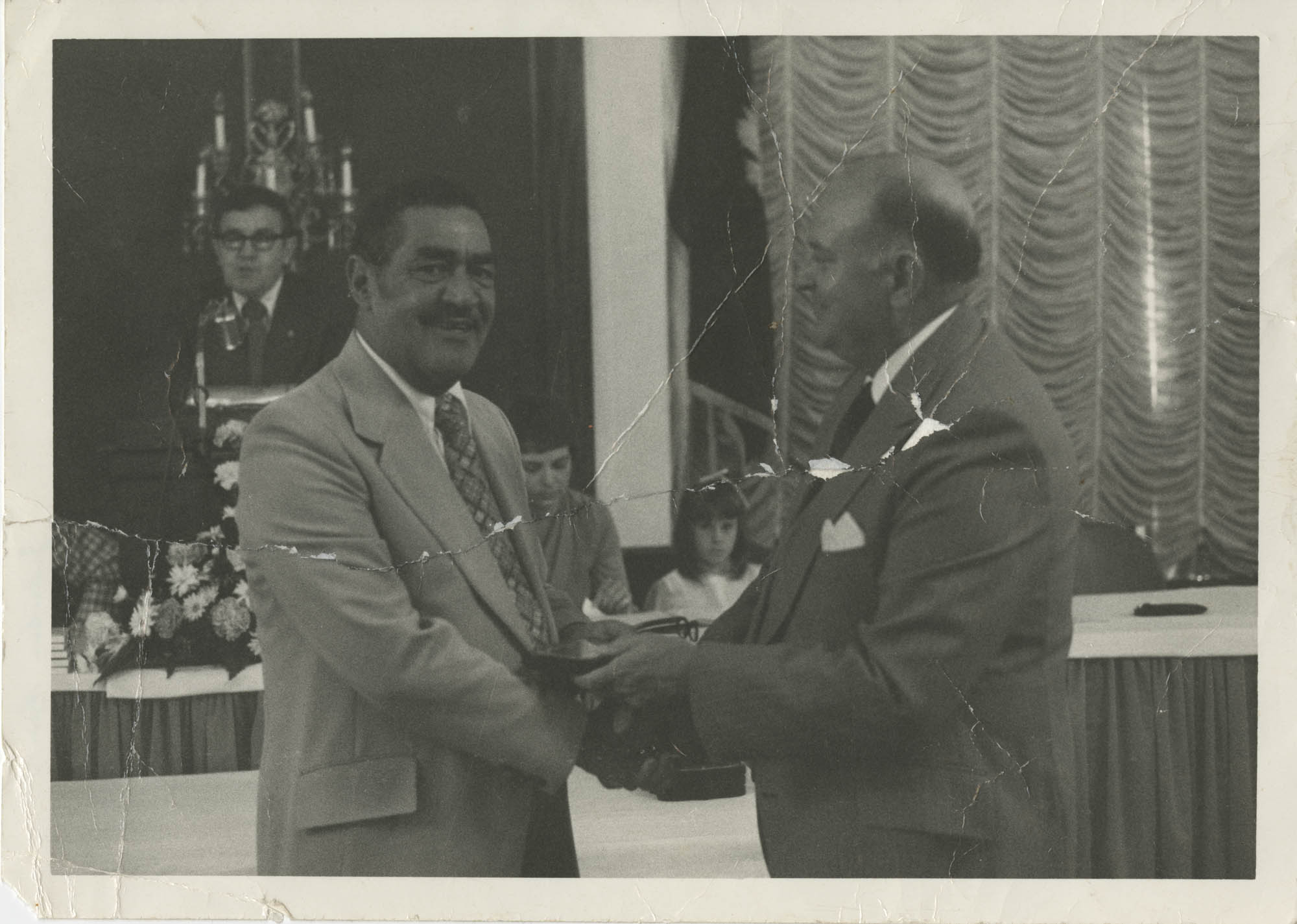 Photograph of J. Arthur Brown Shaking Hands with an Unidentified Man