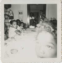 Photograph of Seated Children at a Dining Table