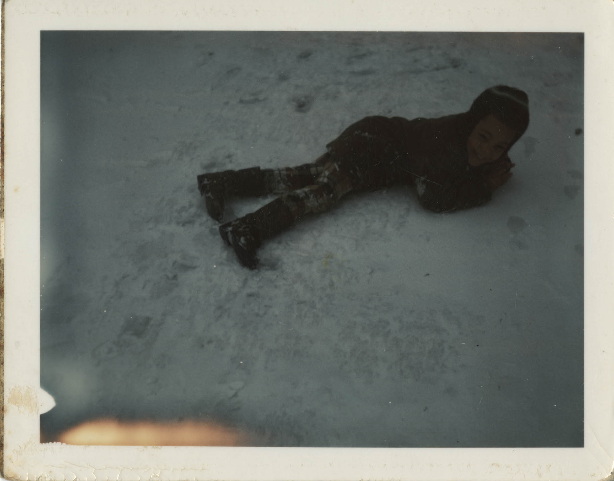 Photograph of Unidentified Child Lying on the Snow