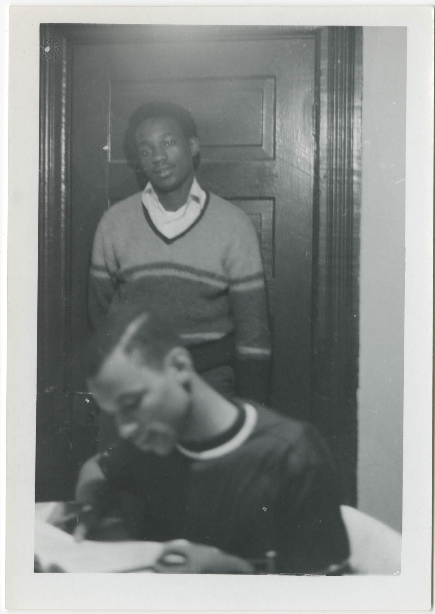Photograph of Two Young Men Studying