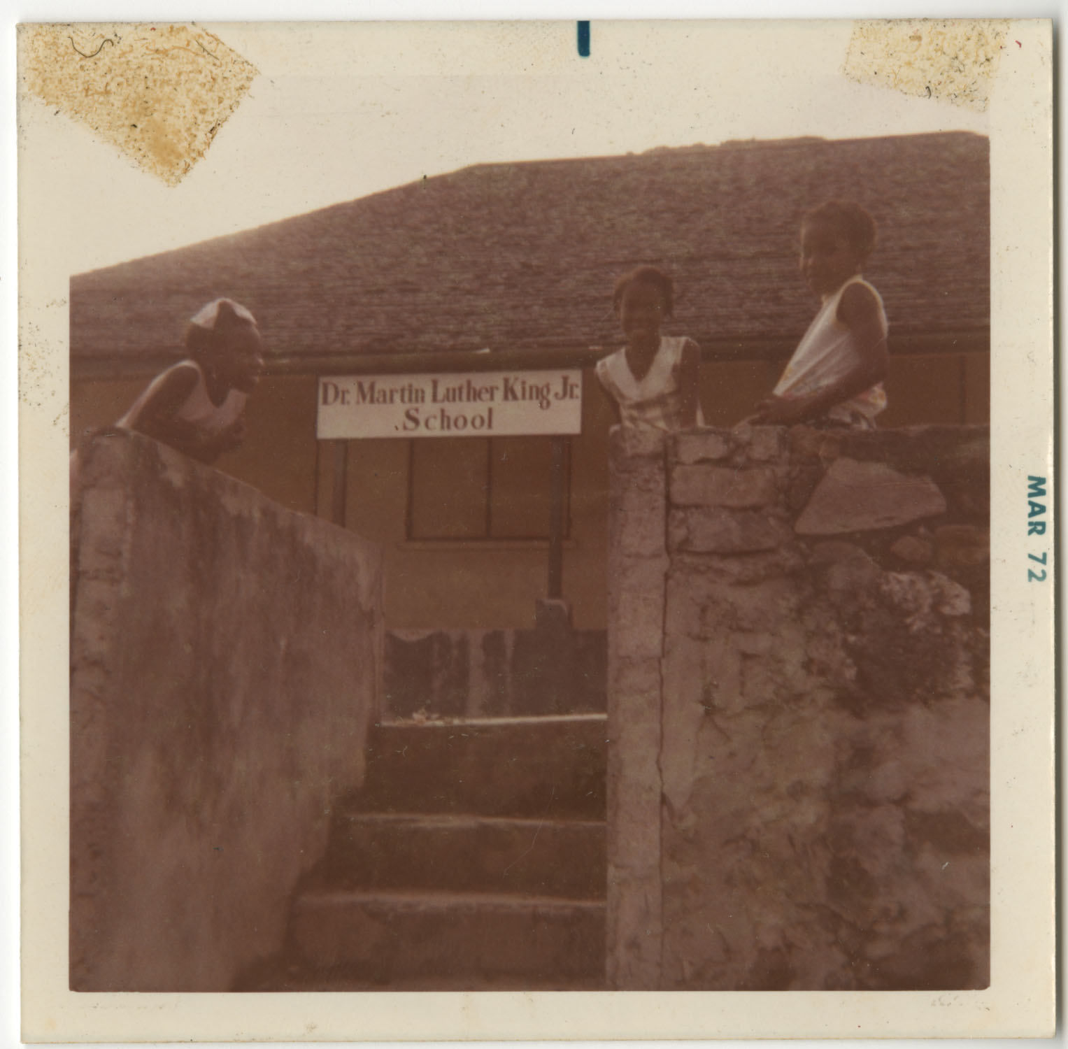 Three Girls Smiling Outside Dr. Martin Luther King, Jr. School, St. Maarten Island, Dutch West Indies
