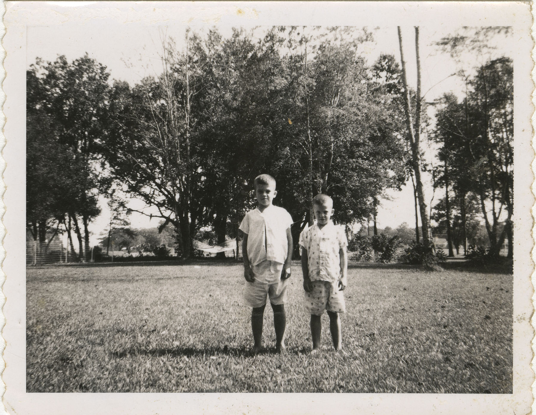 Two boys standing outside