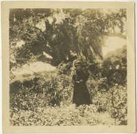 Woman in front of Live Oak tree