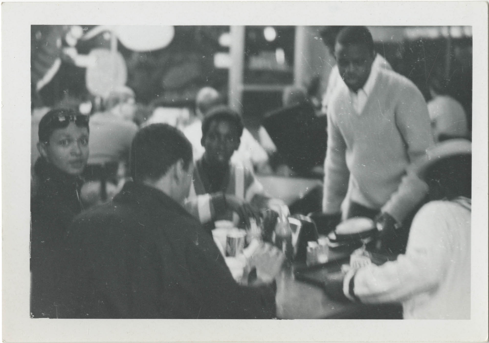 Photograph of Five Young Men Eating