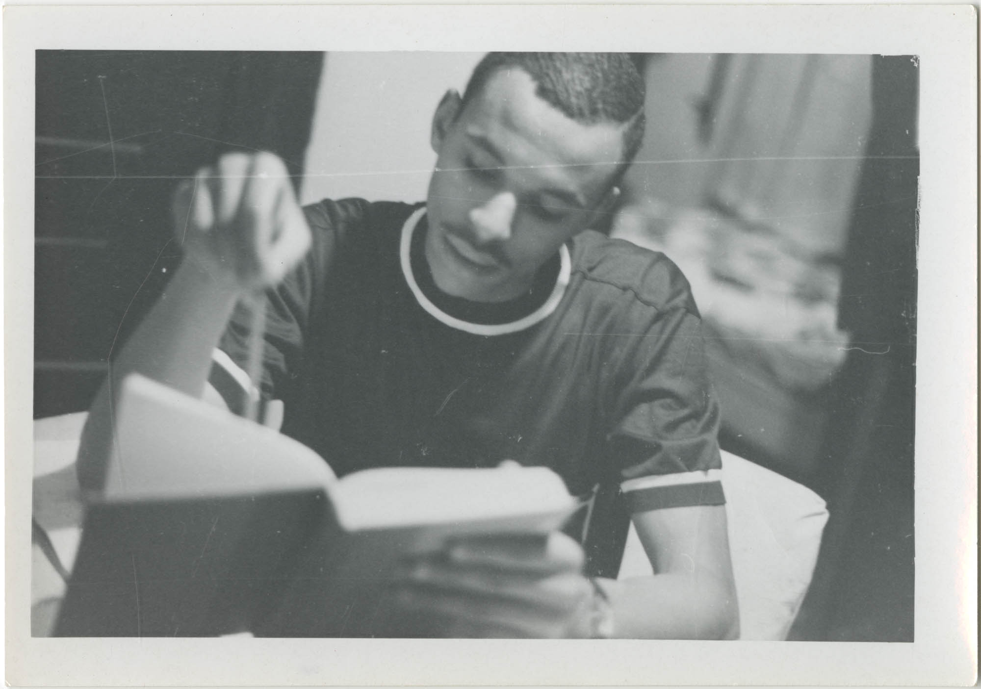 Photograph of Young Man Studying