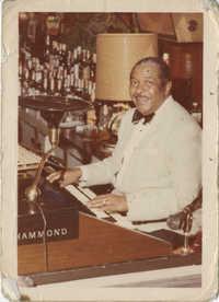 Photograph of Unidentified Man Playing Organ