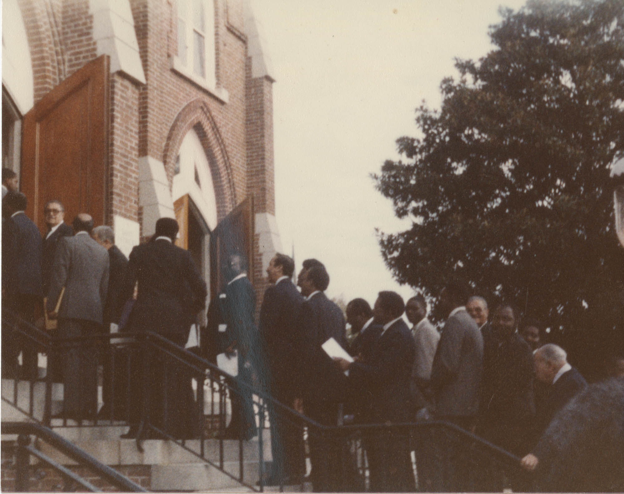 Photograph of a Group of People Walking into a Church