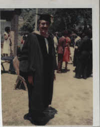 Photograph of J. Arthur Brown Wearing Graduation Cap and Gown