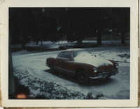 Photograph of Car in the Snow
