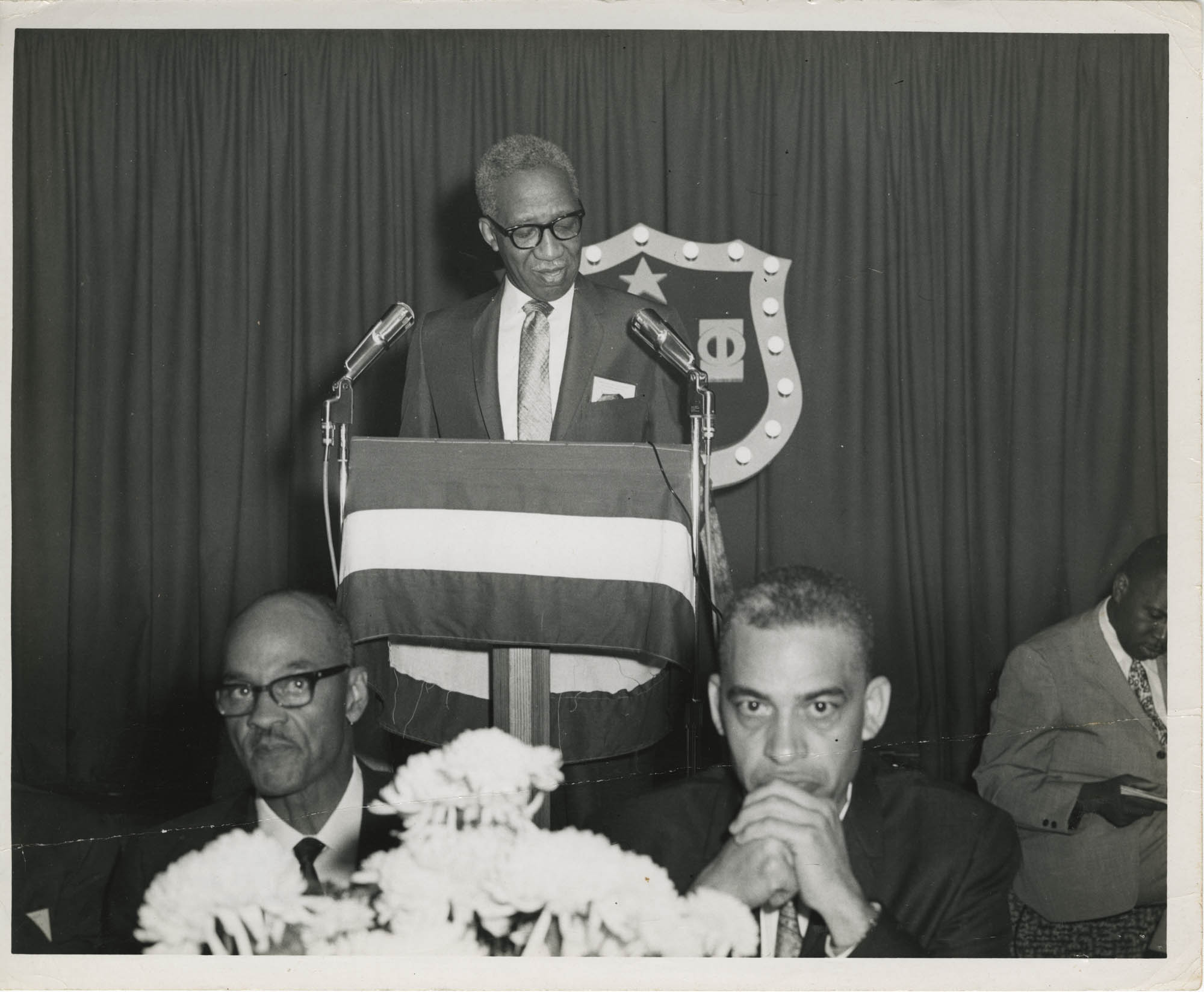 Photograph of Man Speaking at Event