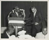 Photograph of Man Presenting Award to Another Man