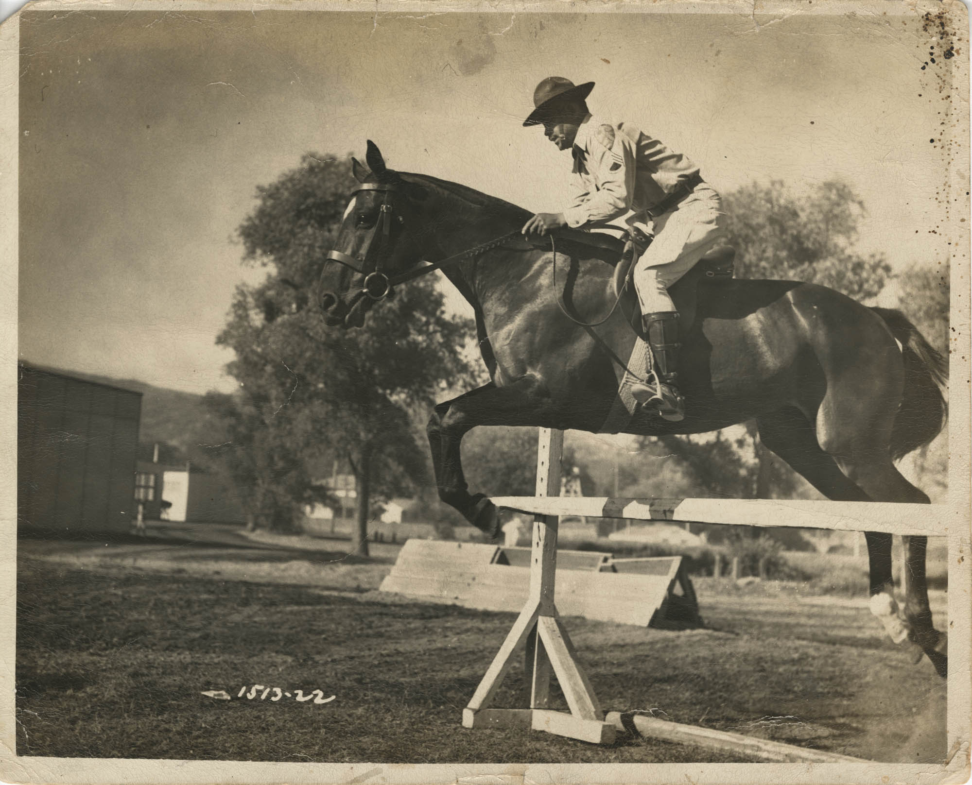 Photograph of a Man in Uniform Riding a Horse