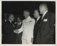 Photograph of Men Shaking Hands at 6th District Meeting of the Omega Psi Phi Fraternity Meeting