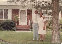 Photograph of Arthurlee Brown McFarlin and Livingston McFarlin Embracing Outside of Home
