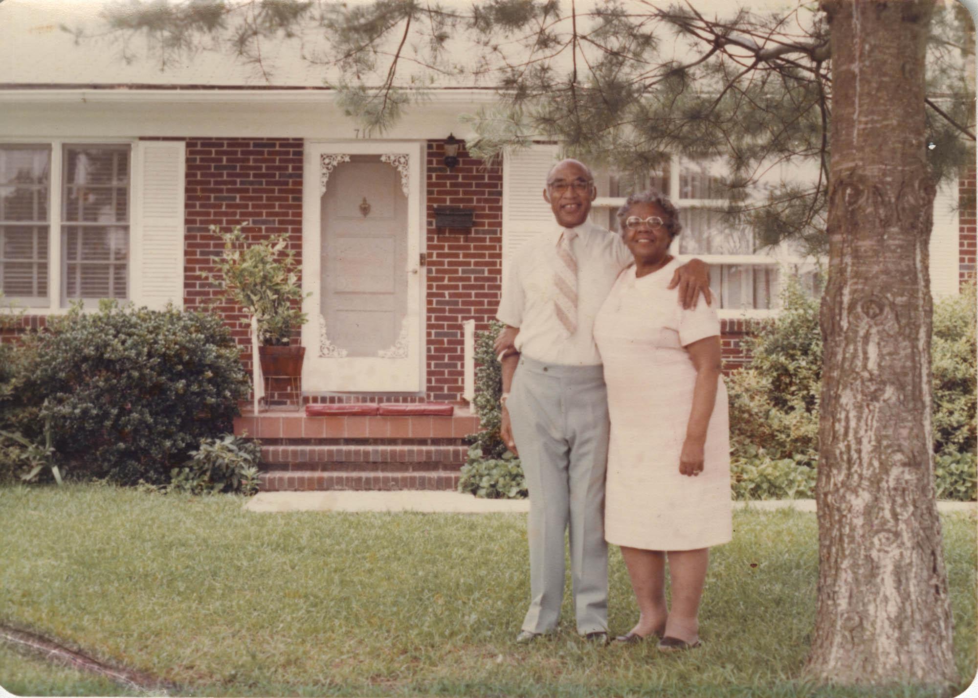 Photograph of Arthurlee Brown McFarlin and Livingston McFarlin Embracing Outside of Home