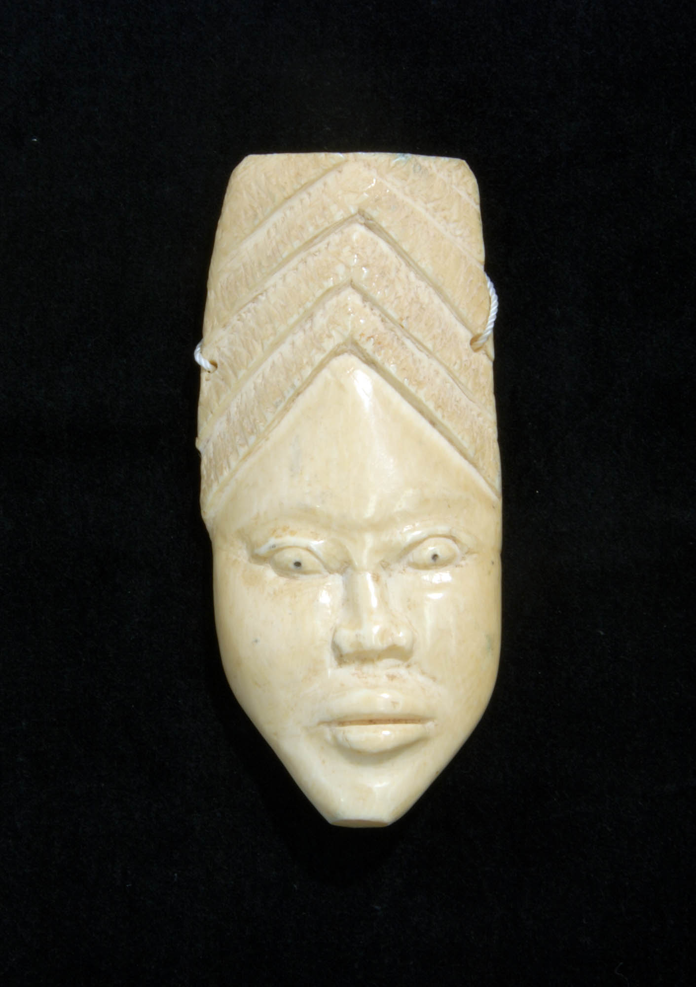 Ivory ornamental face mask