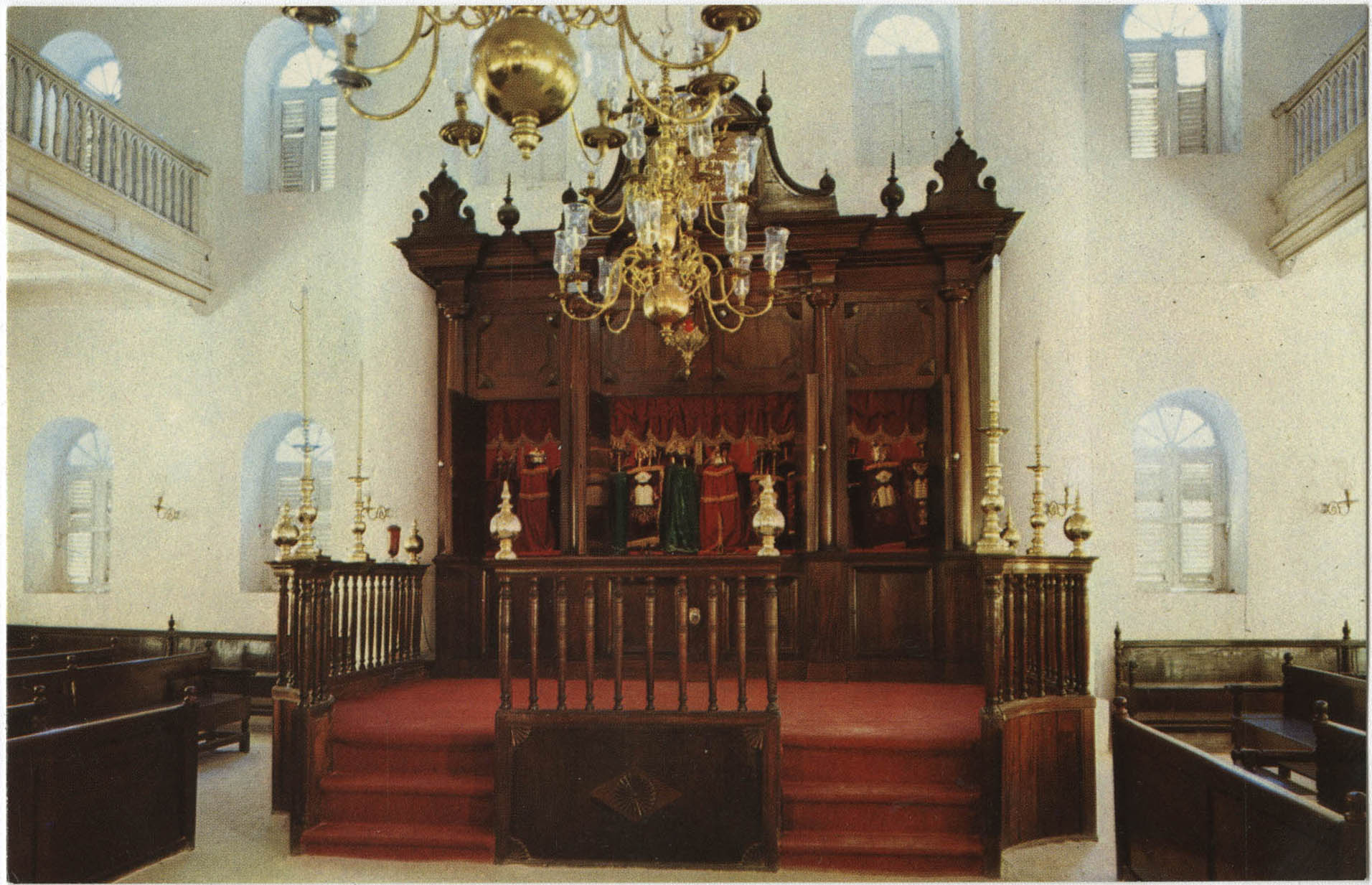 Interior of Mikve Israel-Emanuel Synagogue, dedicated in 1732, oldest in continuous use in Western Hemisphere. View is towards Hechal containing 18 scrolls and is taken from Tebah (reading platform) in center of sandcovered floor.