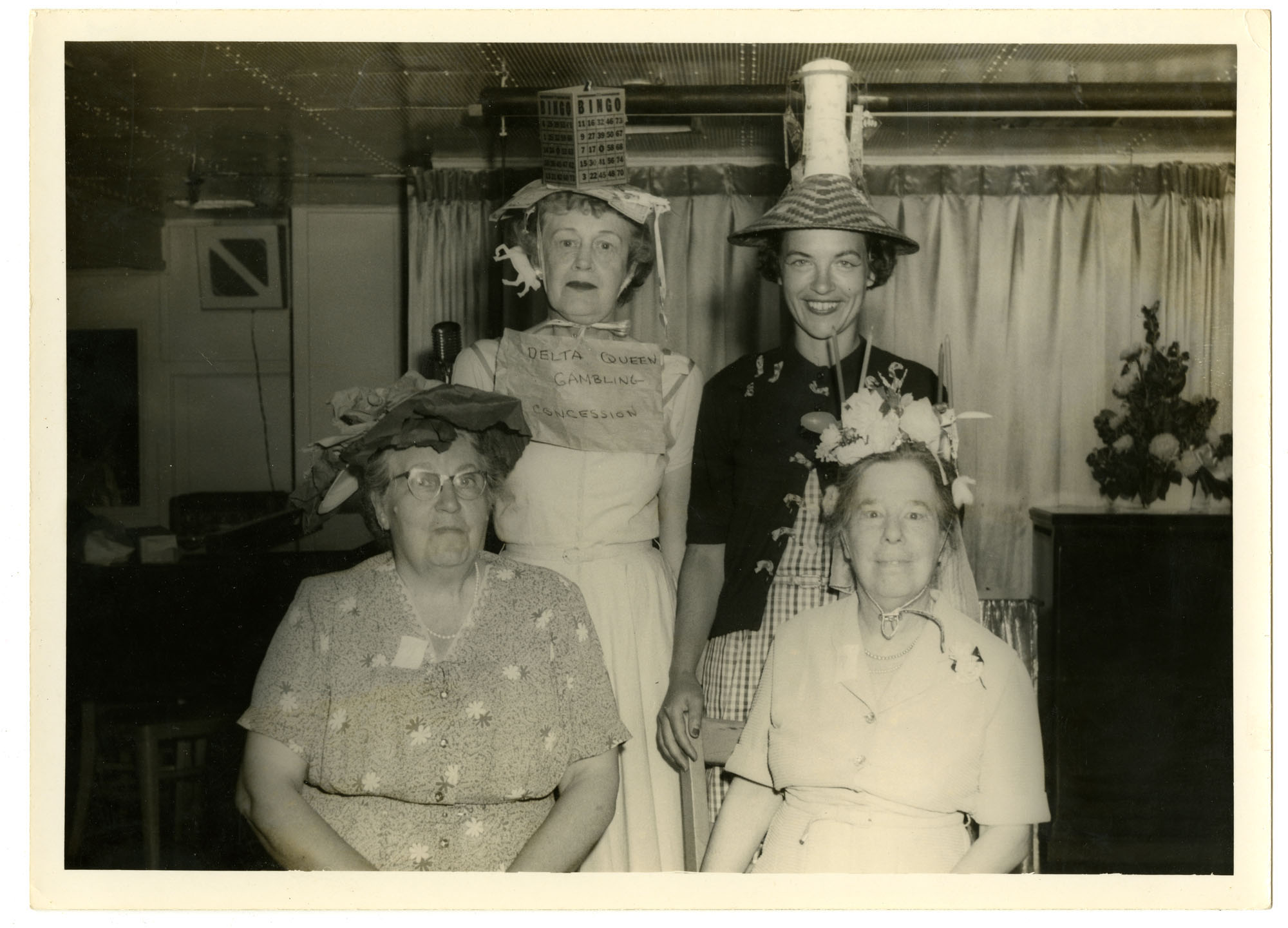 Mabel Pollitzer (bottom right) and women with hand-made hats