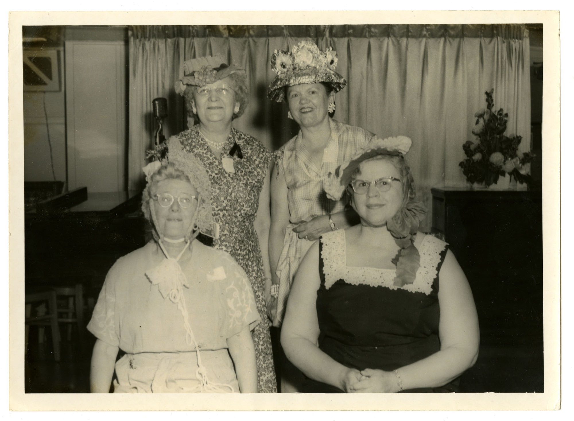 Carrie Pollitzer (left front) and women with hand-made hats