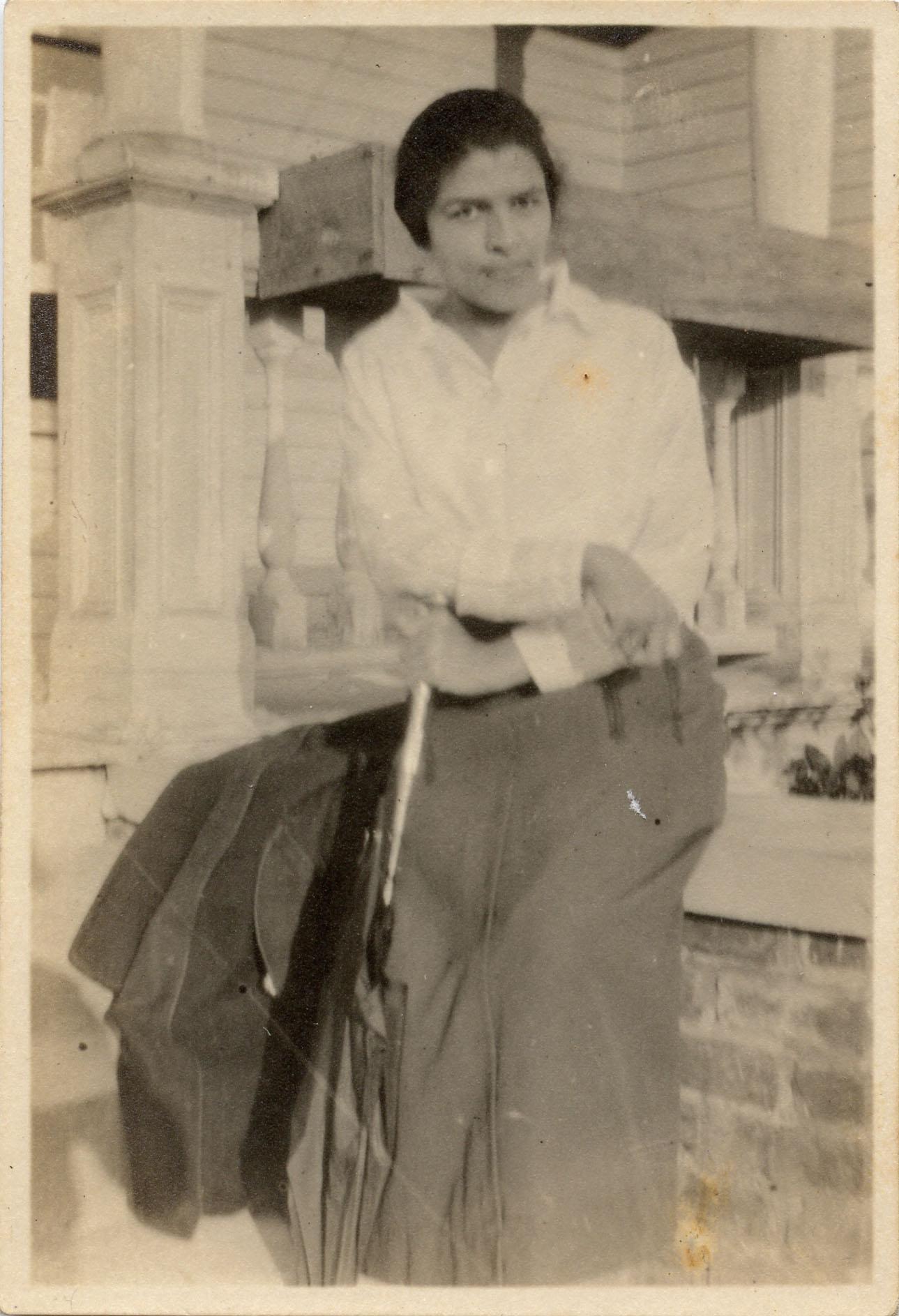 Miriam DeCosta Seabrook seated on porch