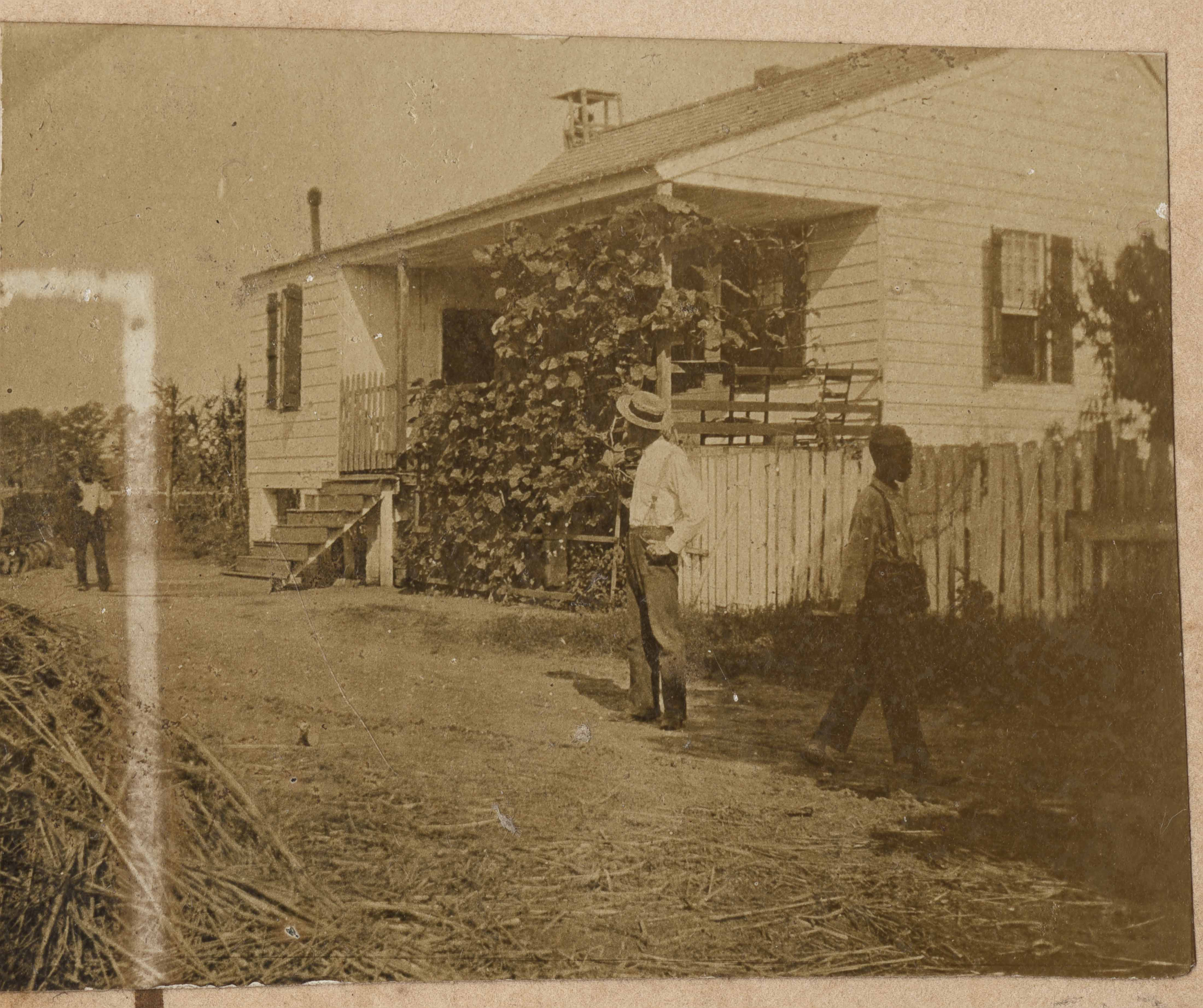 Man and boys near little house on Halls Island