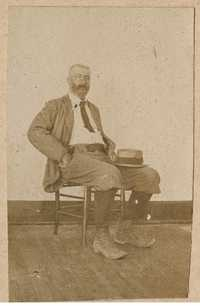 Conrad Donner sitting in chair, looking slightly towards left